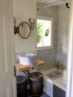 Dove grey tile and white walls with metal accents. Must do this to my bathroom immediately.