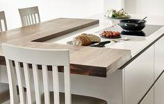 Modern walnut and white kitchen with split level island and bespoke matching breakfast bar stools.