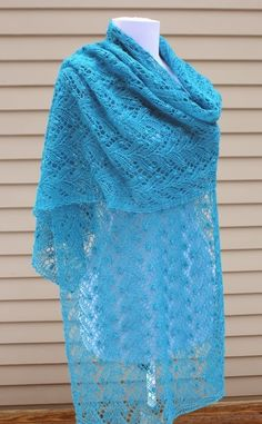 Ta-da!  Here is the first of my planned 12 shawls with Estonian Lace Patterns ( see this blog post for explanation ).        The Janua...