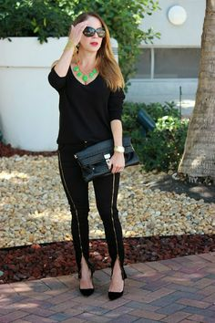 Girl in a hot city- Black zippered jeans and Kelly green necklace.