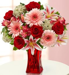 Elegant Wishes™- roses, lilies, Gerbera daisies, alstroemeria, rice flowers and variegated pittosporum $49.99- $69.99