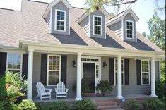 I love that gray and white with the shutters.