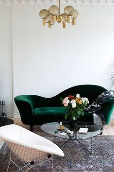 Unique eclectic living room with green curved sofa