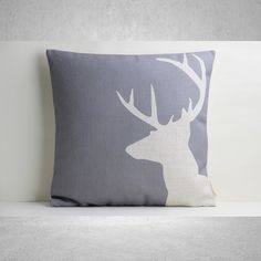 Add a bright touch to your living room or children's playroom with this stag head detail linen and cotton blend cushion cover. Scatter on the sofa or creat.