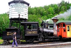 The earliest mountain cog railway, using a system developed by Sylvester Marsh, was built in New Hampshire in the late 1860's. On July 3, 1869, a steam-powered train completed the first trip to the 6,288 feet summit of Mount Washington and was considered one of the wonders of the age. The Mount Washington Railway is the second steepest rack railway in the world and is still running today, with seven steam locomotives and one using diesel: