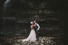 A colorful bouquet, a pretty dress, and a waterfall | Eyekahfoto