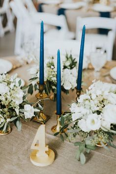 Navy Taper Candles and Gold Vintage Holders | Photo: M2 Photography