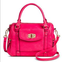 Merona Pink Satchel with Removable Crossbody Strap NWT! Rare find! Stylish and chic handbag is great for everyday wear! This handbag features a turn lock clasp, gold hardware, crossbody strap, multiple interior pockets, and fits an ipad mini.                                              Shell Material: Polyurethane Liner Material: Polyester Closure Style: Zip Closure Compartment details: Interior zip pocket, Exterior front pocket, Interior accessory pocket Handle Type: Double Handle…