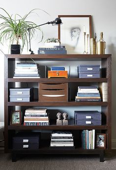 The key to making any bookshelf look immaculately streamlined is to load it with beautiful boxes. It's the perfect way to hoard anything from receipts to your washi tape collection without having your belongings look like a mess. Source: Manuel Rodriguez for One Kings Lane
