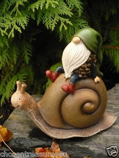 Garden Gnome Riding on a Snail Figurine. Garden Gnome Riding on a Snail Figurine. Clay Projects, Clay Crafts, Twig Crafts, Fairy Land, Fairy Tales, Gnome Village, Gnome House, Paperclay, Fairy Houses