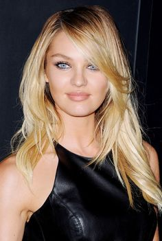 Candice Swanepoel stuns with shiny, side-swept blonde locks and subtle makeup.