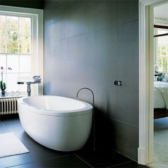 it doesn't have to be a huge bathroom, as long as it fit a free standing bath, wet room and vanity!