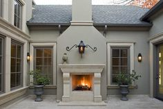 """The stucco has an integral color to it. The color is Lunar #FS64 FT-Tone (Fine Texture).   The cast stone is buff.   The exterior trim paint is Sherwinn Williams #SW3524 Chestnut."""""""