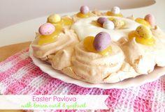 Easter Pavlova with Lemon Curd & Yoghurt - a light and fresh Easter dessert that looks impressive but is super-simple to make! | www.pinkrecipebox.com