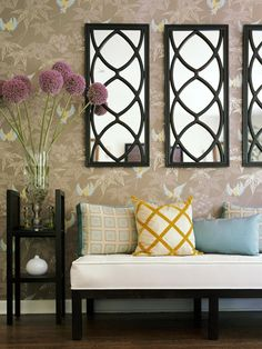 Love how this foyer was pulled together! Wallpaper-pillows-mirrored art work-black side table-bench