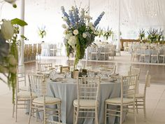 Wisteria Flowers and Gifts | Rustic Dream wedding tent with large centerpiece