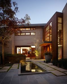 Refined,Functional and Open Family Home Design Nestled BetweenTrees - http://freshome.com/2014/10/14/refined-functional-and-open-family-home-design-nestled-between-trees/