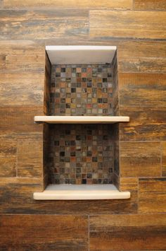Wood-look tiles in this custom shower, with metallic mosaic accents!