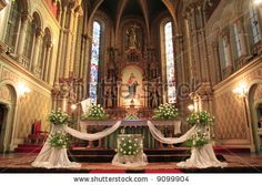 Interior of a catholic church, beautifully decorated for a wedding ceremony
