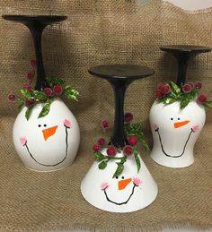 Christmas wine glass candle holders Snowman wine glasses Snowmen wine glass glass candle holders Painted wine glasses https://www.etsy.com/listing/257233405/snowman-wine-glass-candle-holder