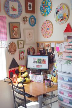 Desk in the perfect little sewing room with gorgeous wall art