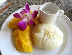 Mango with sticky rice and coconut milk - a traditional thai dessert.