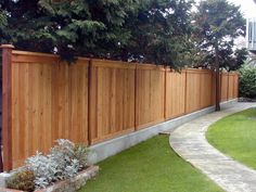 privacy fence ideas - love this...-especially the concrete footing.
