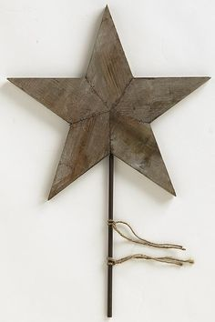 Rustic tree topper...  or put the star in a glass container or  stick it in your planter. Nice detail: the pieces join together with staples.