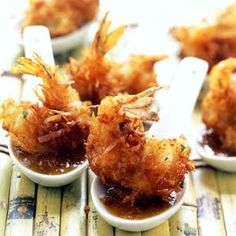 This is a delicious recipe for Coconut Shrimp w/Maui Mustard Sauce. Infuse large, juicy shrimp with coconut milk, cilantro, and lime juice for an explosion of island flavor. Coated in a light coconut breadcrumb mixture and fried to perfection, these shri Seafood Dishes, Fish And Seafood, Seafood Recipes, Appetizer Recipes, Appetizers, Cooking Recipes, Fresh Seafood, Cooking Tips, Recipes Dinner