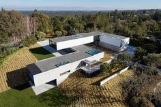 OZ Residence - Bird's Eye View - The house is located on a hilltop, with San Francisco visible in the distance. The structure was designed as several L shaped pieces.