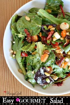 """Easy Gourmet Salad - What makes it """"gourmet?"""" Well, there are a few add-ins that make it special: sundried tomatoes, feta cheese, golden raisins and toasted pine nuts… oh yeah., and a simple, homemade salad dressing."""