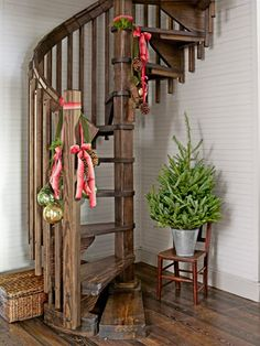 Easy way to decorate for the holidays: Add velvet ribbons, ornaments, and pinecones to the banister.