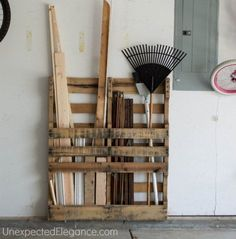 Turn an old pallet on its end to instantly organize everything in your garage.