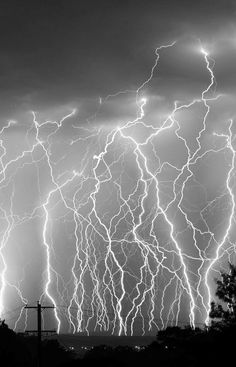 lightning. It looks like it's going from the ground to the sky