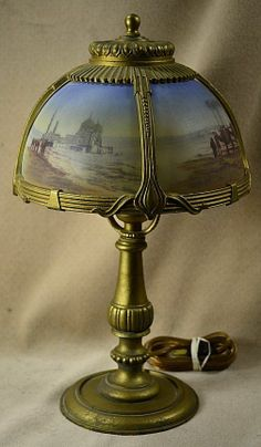 VNTG GOLD PATINATED SPELTER/WHITE METAL VANITY LAMP - ARAB SCENES ON GLASS SHADE