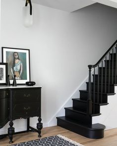 Entryway painted Benjamin Moore Decorator's White with contrasting black staircase. stairs Before & After: A Row House in Jersey City Gets a Fresh, Modern Makeover by Mowery Marsh Architects Black Stair Railing, Black Staircase, Staircase Design, Black Hallway, Stair Spindles, Staircase Runner, Railings, Up House, House Stairs