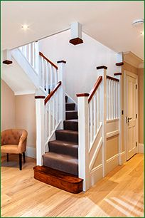 A white primed softwood staircase, featuring two quarter landing turns. The oak bullnose step, handrails and newel caps create a stylish contrast against the other primed elements of the staircase. Bespoke Staircases, Wooden Staircases, Wooden Stairs, White Staircase, Curved Staircase, Staircase Design, Hallway Designs, Hallway Ideas