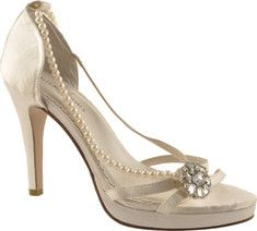 This design is an instant favorite for every bride. The Dazzle features a beautiful rhinestone ornament and side pearl strand detail. It has a .75 inch platform height and a leather sole.
