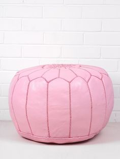Beautiful Moroccan leather pouffe in Flamingo, made by hand with intricate grey embroidered design. Perfect for your little girls playroom or bedroom.100% leather.Approx size: Diameter 53 x height 28 cm (21 x 11 inches)Delivered Unstuffed.Product