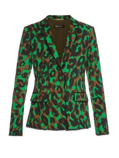 Donatella Versace indulges in eye-popping print for SS16. A star on the runway, this single-breasted cotton-gabardine blazer is printed with bold green and brown camouflage splashes, and trimmed with raw edges to enhance the safari vibes. Emulate the runway look with the matching trousers.