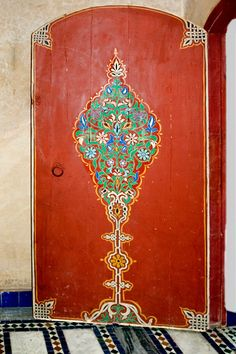 Red flowered Moroccan doorway.