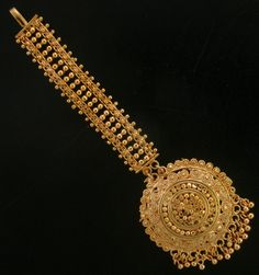 Bollywood Bridal and Gold Tone Handmade Bridal Maang Tikka.Traditional Indian wedding Jewelry. High quality finish with very shiny Gold Finish, very similar Gold Jewlery.Tikka measures : Length (approx) - 5 1/4\