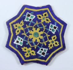 A Safavid Cuerda Seca Glazed Pottery Star Tile, Iran or Central Asia, 16th/17th century - Indian & Islamic 27 september - 6 October 2011 - Auction Atrium