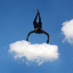 A man appears to embrace the clouds as he is seen against the summer sky while somersaulting from the diving board at the Dallenberg public ...