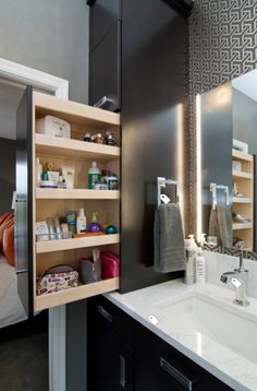 Deep cabinet next to bathroom sink with pullout storage. #deepbathroomsink