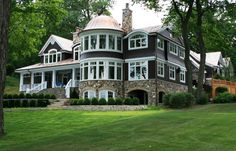 *Wow. This house is stunning!! I love the navy shingles, as I'm a BIG fan of shingle-style houses, and I've never seen a color other than the typical brown used. Pretty to look at, but link doesn't offer any additional photos of it (except a porch FP).