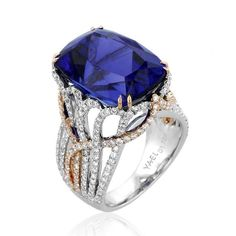 Mariana 18k white and rose gold ring is set with a 19.63 ct. tanzanite that is held in a setting with multiple shanks lined with 1.71 ct. t.w.