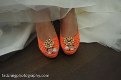 Sloane's  fabulous orange shoes that matches her bridesmaids dresses. So pretty! Photo by Tad Craig Photography