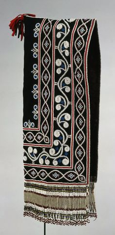 Eastern Subarctic ~ Eastern Cree  | Woman's hood; stroud, cotton cloth, glass beads, silk ribbon, cotton thread | 19th century (1830 - 1850)  ||  Displays a style of graceful floral beadwork typical of the James Bay Cree. Hoods were a necessary head-and-shoulder covering in the bitter winters of the North; however, finely beaded examples such as this one may have been reserved for special occasions.