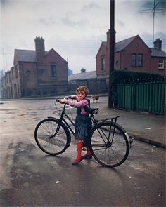 "raiseyourseat: ""Girl with the bicycle, Dublin, 1966 and the photography of Evelyn Hofer. She barely reaches the pedals. "" I'm crazy about this shot, Dublin in anniversary of the Easter. Color Photography, Street Photography, Vintage Photography, Narrative Photography, Photography Exhibition, Heart Photography, Candid Photography, Documentary Photography, Pompeii"